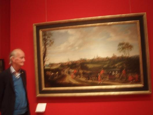 Hans Krol bij het schilderij van de intocht van Adriaen Pauw in Münster door Gerard Terborgh in het Stadsmuseum van Münster