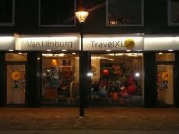 Reisbureau Van Limburg bij avond, Binnenweg 199