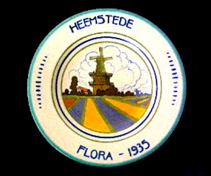 Souvenirbord Flora 1935 met afbeelding van het molentje van Groenendaal (zie: www.flora1935.nl)