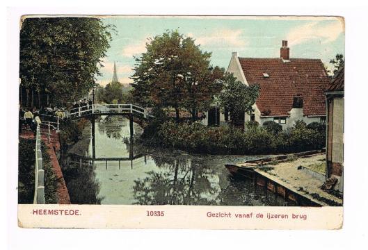 Gezicht vanaf de IJzeren Brug met de St.Bavokerk in de verte, circa 1910
