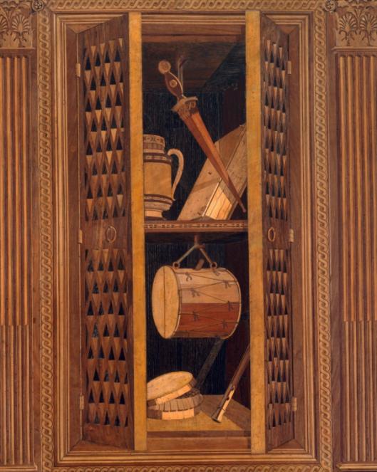 Uit: studiola van Frederico da Montefeltro. Het inleg-hout lijkt drie-dimensionaal om de indruk van ruimtelijkheid te geven (trompe l'oeil). Het perspectief is afkomstig van de architect Filippo Brunelleschi