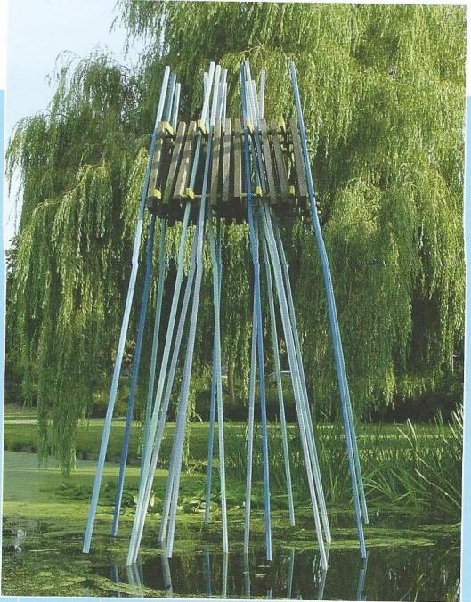 Kunstwerk van Nicole van der Heijden, in 1989 geplaatst in het Beatrixplantsoen van de wijk Merlenhoven. De kunstenares heeft vooral beweging in haar werk willen benaderen
