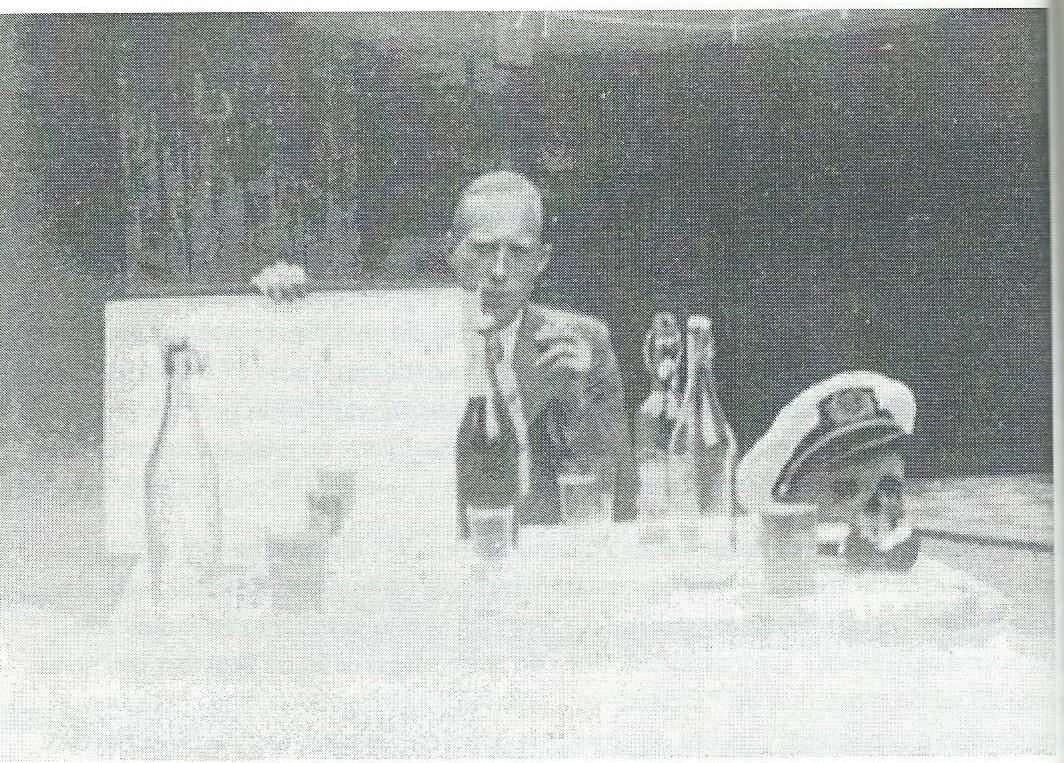 De enige foto die Dick van den Hoorn van Jan Oom maakte: 17 augustus 1939 tijdens een tuinfeestje, een paar weken voor het uitbreken van WOII, toen Jan de school van Eadio Holland verlietr. Op de rafel limonadeflessen plaats van wijn. Een macaber detail is het doodshoofd met daarop een uniformpet (zomeruitvoering) van Radio Holland en eronder de boord van het uitgangsuniform: