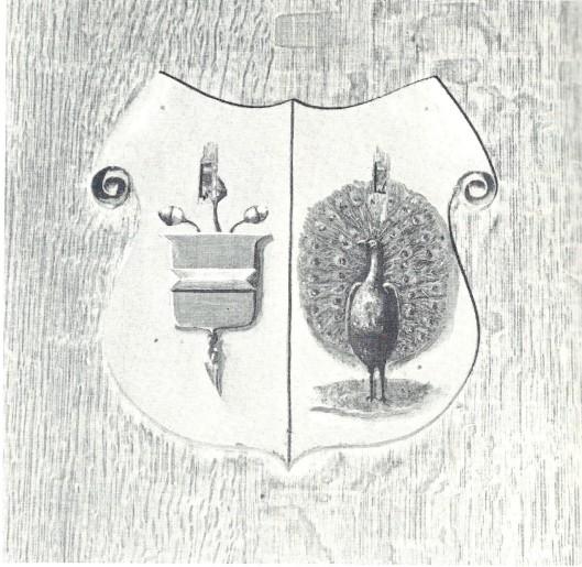 Het geslachtswapen van de families Willink (links in blauw drie gouden eikels aan een gouden takje, met het wapen van Bennebroek als hartschild) en Nutges (rechts in baluw een pronkende pauw), bevestigd op de bank der ambachtsheren van Bennebroek in de Hervormde Kerk.
