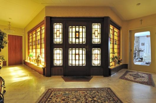 Glas-in-lood ramen in een pand aan de Willinklaan te Bennebroek