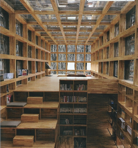 "Huisbibliotheek in Komazawa, Japan. ""TYjis two-story timber house has an external wall made of neighboring structures. Slatted floors offers an unexpected collection between one story to the next""."