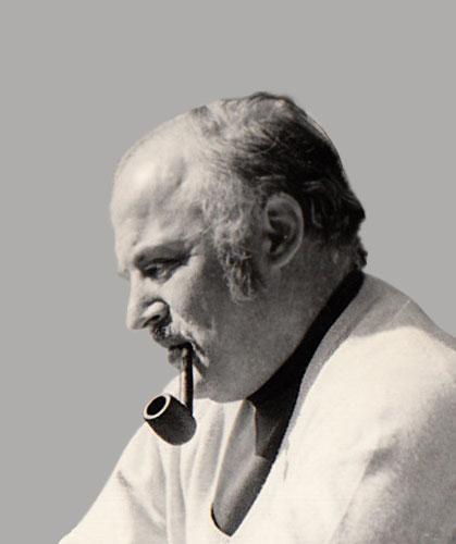 Portret van Dick Reumer en profil met karakteristieke pijp