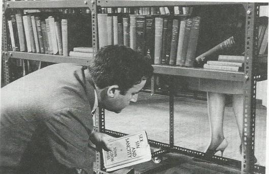 Peter Sellers, randy librarian, in the film: 'Only two can play'.