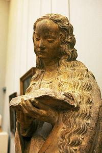 Lezende heilige. Toegeschreven aan de 15e eeuwse Spaanse beeldhouwer Juan de la Herta. Dijon, Frankrijk