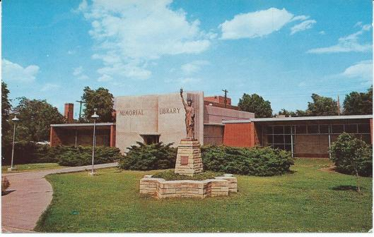 Memorial Library in Cooper Park, LIBERAL, Kansas on U.S.Hwys. 54 and 83 has the World's Largest Book in Book Front Entrance