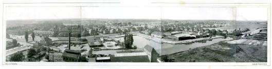 Panoramafoto met links o.a. gebouw Openbare Werken en deel Gasfabriek. Aan de Havenstraat Teeuwen's kolen- en oliehandel (nu kantoorgebouw) en links daarvan achter het huizenblok: Nefabas asbestfabriek