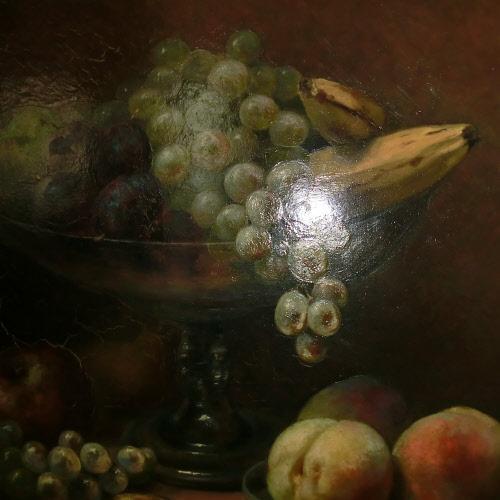 Stilleven met fruit in en naast een glazen schaal